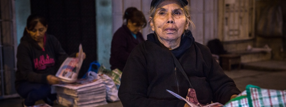 Newspaper vendor in Lima, Peru