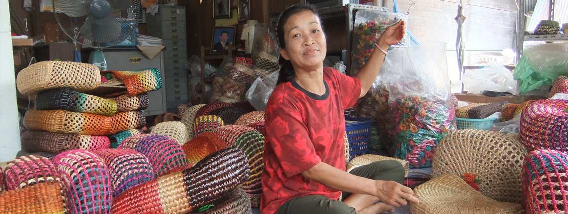 Thai home-based worker weaving handbags