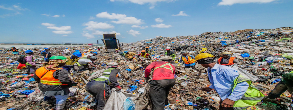 Waste pickers collecting recyclables on Kpone Landfill in Accra, Ghana