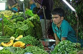 Vendors and customers at the Saturday weekly market in Vasant Kunj, Delhi.
