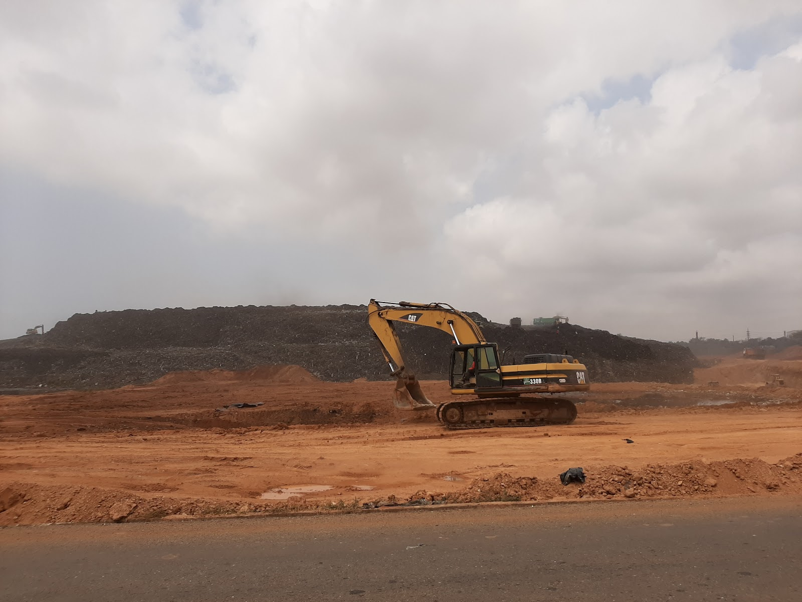 bulldozers at Kpone Landfill in Accra, Ghana