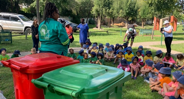 Johannesburg reclaimer teaches children about separating recycling