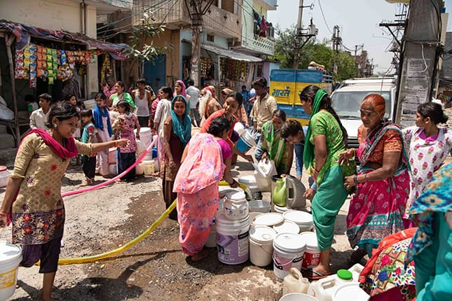 Women collecting water and struggle for basic services.