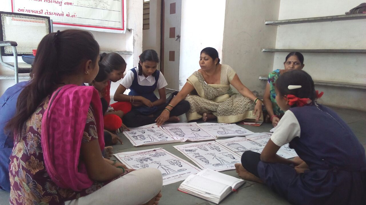 Pushpa works with young children to talk about health