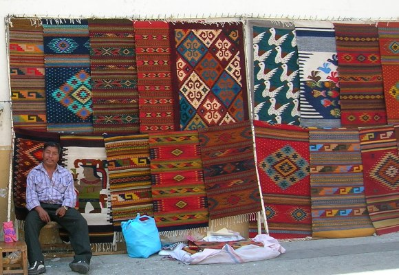 Vendor selling rugs, Mexico