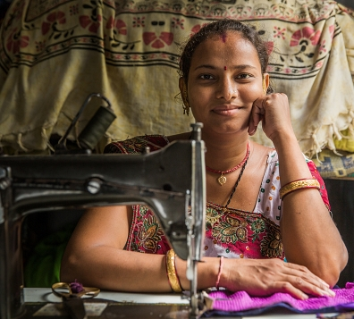 home-based apparel worker at sewing machine, Ahmedabad, India