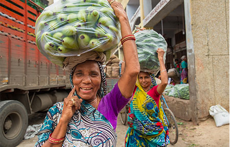 Shantha Solanri does back-breaking work as a head loader in Ahmedabad's teeming main vegetable market.