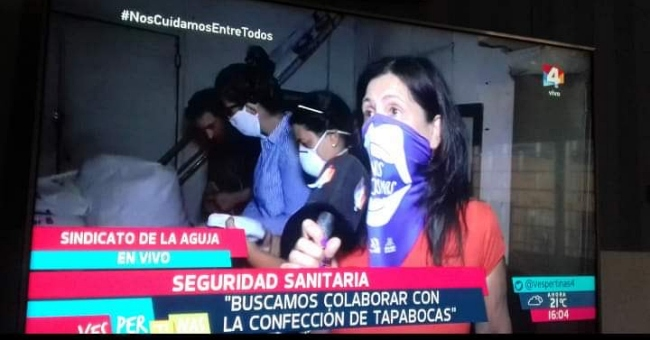 television news screenshot making masks in Uruguay