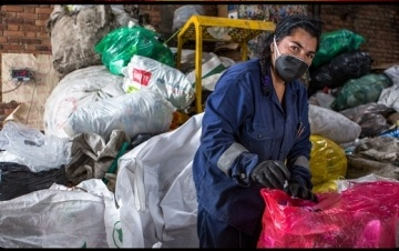 waste picker in mask and gloves